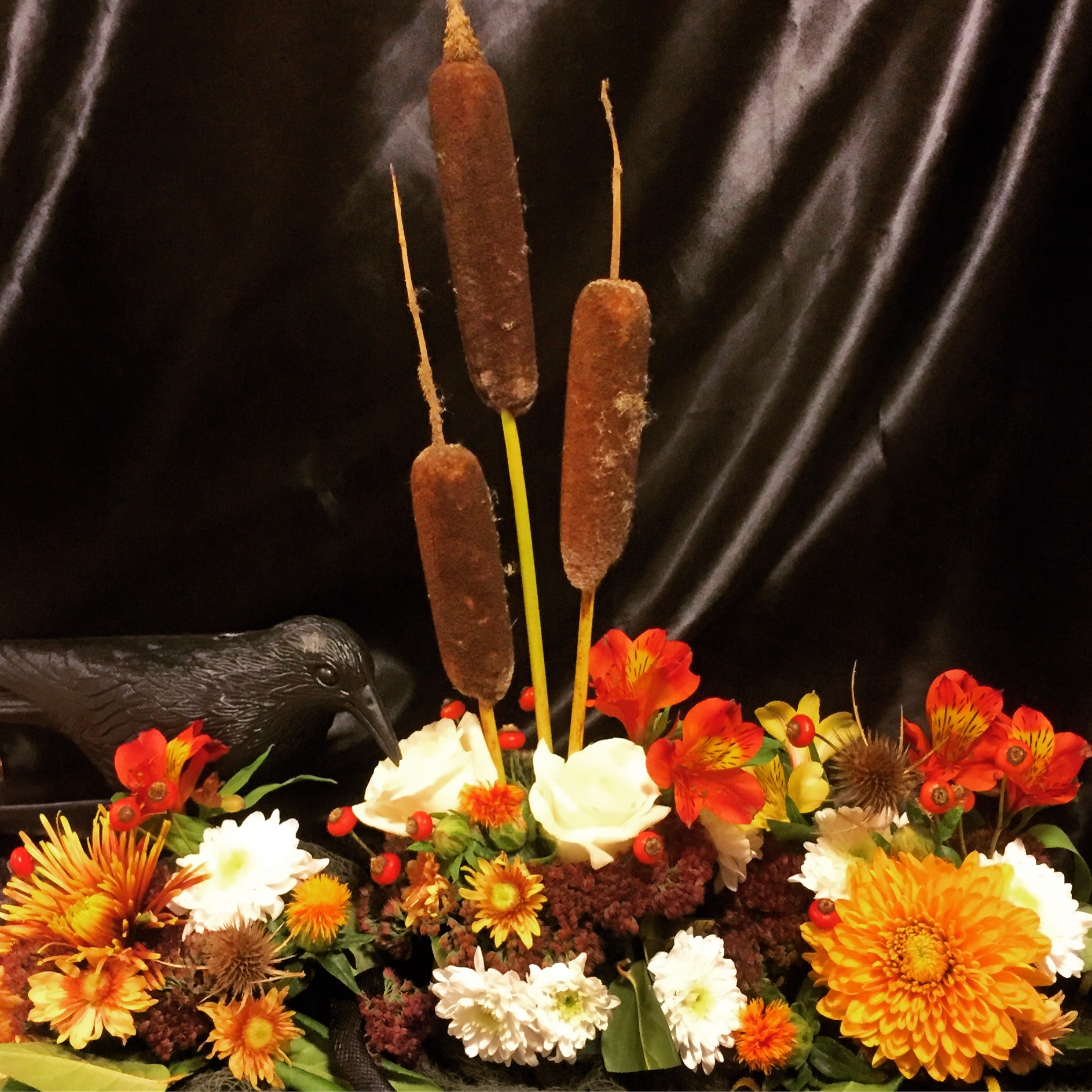 halloween flower arrangement with snakes and crow