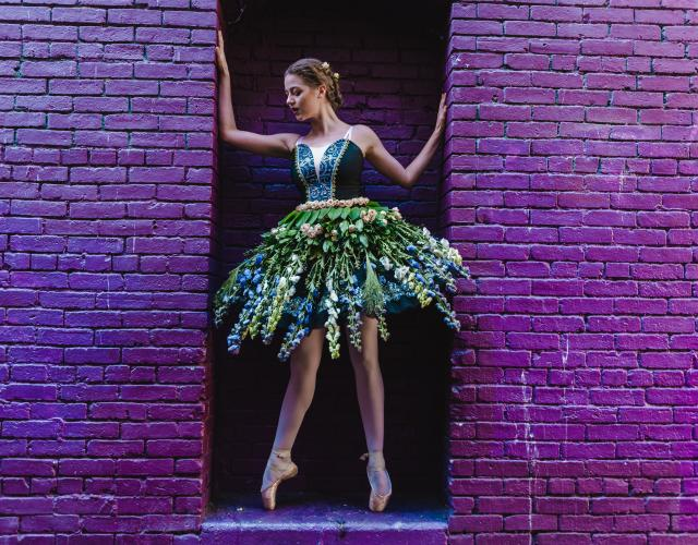 Ballet dancer with floral tutu and purple wall